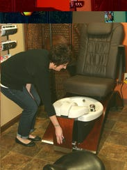 Shelley Babcock prepares one of the pedicure stations.