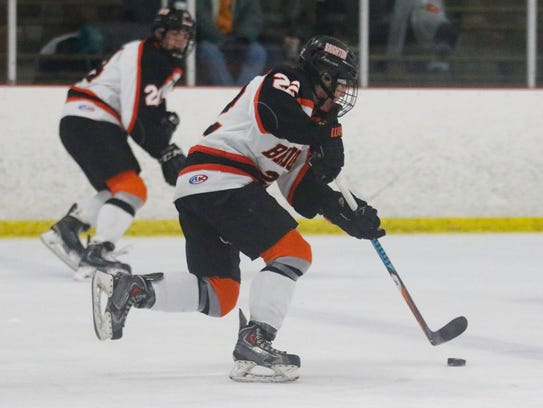 Matthew Kahra (22) brings the puck up the ice in Brighton's