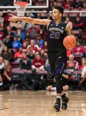Washington Huskies guard Markelle Fultz (20) signals a play against the Stanford Cardinal in the second half at Maples Pavilion. Stanford won 76-69.