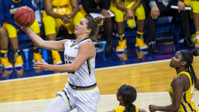 Notre Dame's Kathryn Westbeld (33), left, goes in for a layup next to North Carolina A&T's Whitney Martin (3), center, and Michelle Fitzgerald (23) during the first half of a first-round women's college basketball game in the NCAA Tournament, Saturday, March 19, 2016, in South Bend, Ind.