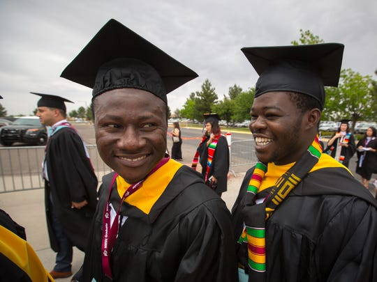 NMSU students Fredrick Ayivor, left and Shitu Jimoa Fawaz wait to enter the Pan American Center for a graduation ceremony, May 14, 2016.