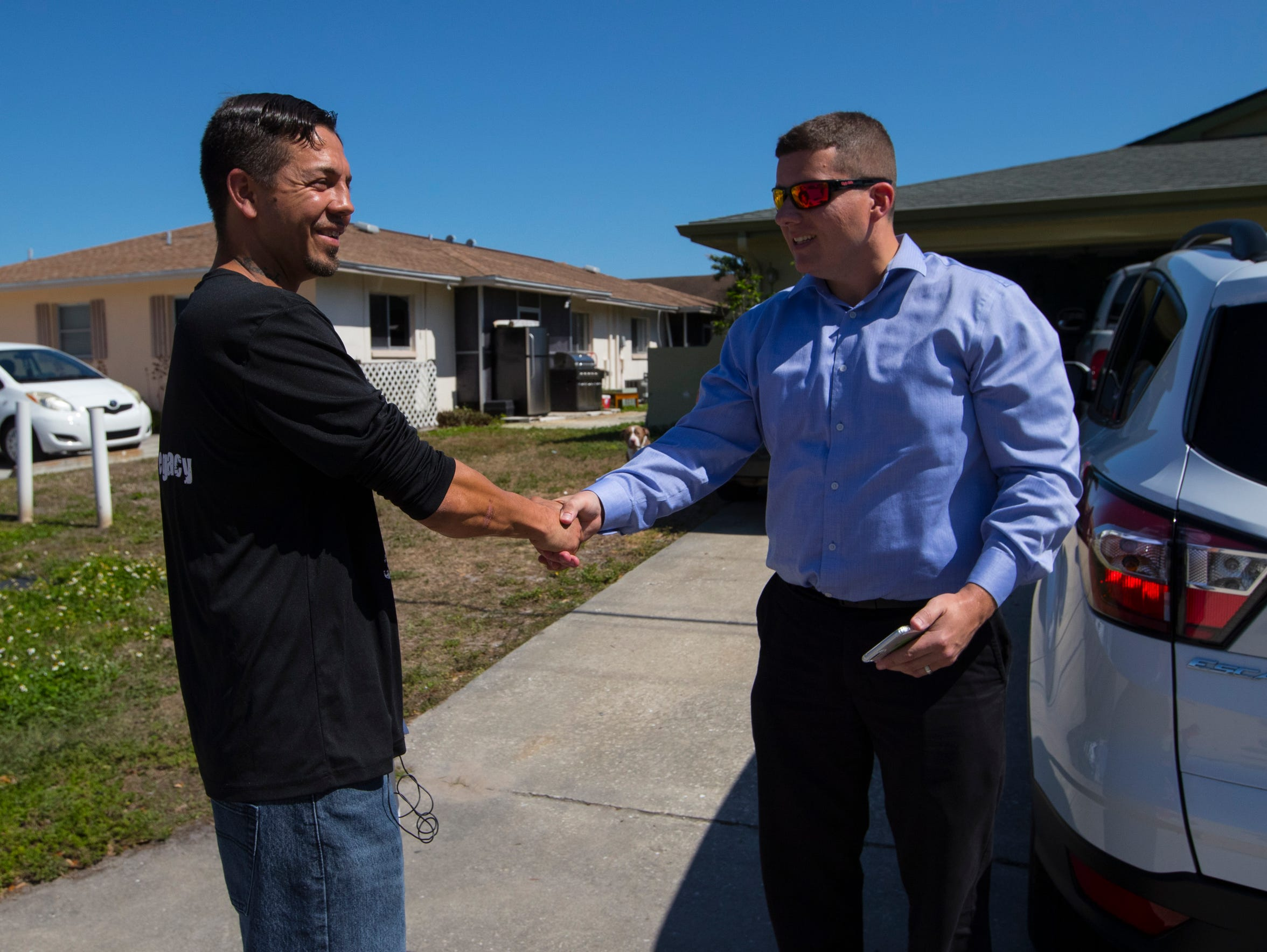 Cape Coral resident Stephen Hunt, 35, greets Matthew Lipani, an assistant manager with Surterra. Hunt is one of many patients opting for home delivery services of their medical marijuana products.