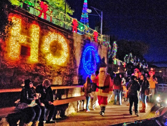 Santa leads revelers as Jerome lights up the mountain.