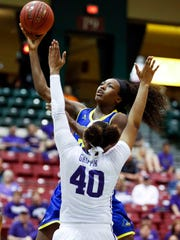 Delaware's Nicole Enabosi shoots over James Madison's Da'Lishia Griffin in the first half of a CAA tournament semifinal at the Show Place Arena in Upper Marlboro, Md. Friday.