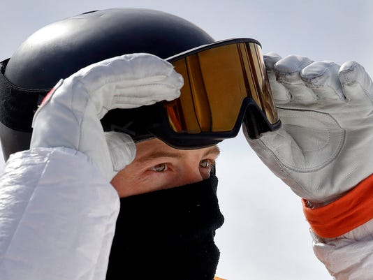 Shaun White, of the United States, looks at his score during the men's halfpipe qualifying at Phoenix Snow Park at the 2018 Winter Olympics in Pyeongchang, South Korea, Tuesday, Feb. 13, 2018. (AP Photo/Lee Jin-man)