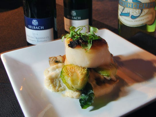 Seared Scallop,Truffled Celery Root Puree, Brussel