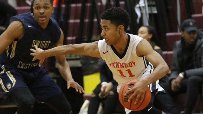 Junior guard Jaylen Colon (11) leads second-seeded Kennedy against No. 7 Hawthorne at Saturday's quarterfinals of the Passaic County boys basketball tournament.