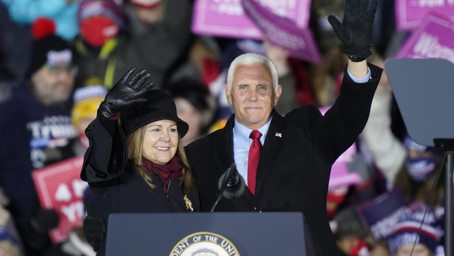 Vice President Mike Pence and his wife Karen wave at a campaign rally, Monday, Nov. 2, 2020, in Grand Rapids, Mich.