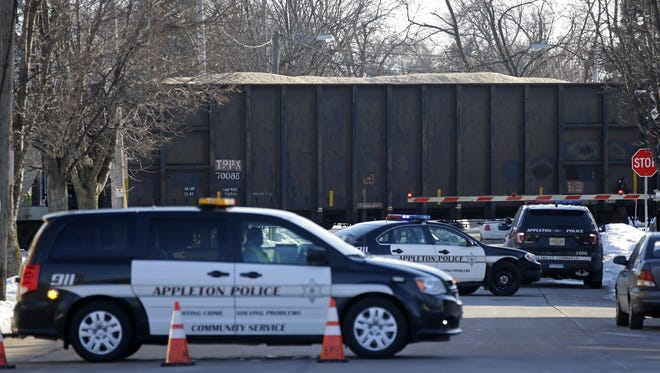 Appleton police investigate a train versus pedestrian crash at South Locust and West Lawrence streets on Sunday.