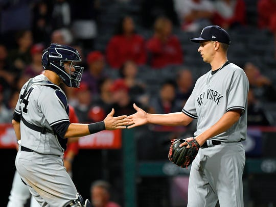 New York Yankees catcher Gary Sanchez, left, and relief