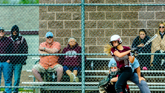 Shelby Steele of Eaton Rapids swings for a basehit in the 1st inning of the second game the Greyhounds' double-header with Portland Monday May 9, 2016 in Eaton Rapids.  KEVIN W. FOWLER PHOTO