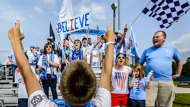 Tim Howard (foreground) leads the Sons of Ransom in a cheer prior to the Lansing United National Premier Soccer League Regional final game with Fort Pitt Sunday July 20, 2014 at Archer Stadium in East Lansing.