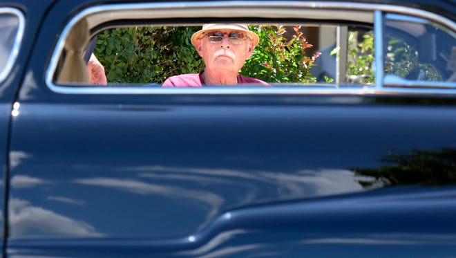 Jesse Hallett of Mount Joy, Lancaster County, sits next to his 1950 Mercury at the Wyndham Garden York, where registration for the 44th Annual Street Rod Nationals East took place Thursday, June 1, 2017. He said he has attended the event every year.  Bill Kalina photo