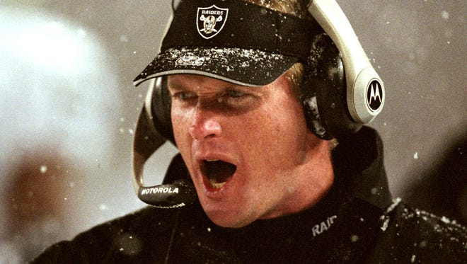Oakland Raiders head coach Jon Gruden shouts instructions during their 16-13 overtime loss to the New England Patriots in an AFC Divisional playoff game in Foxboro, Mass. in this Jan. 19, 2002 photo.