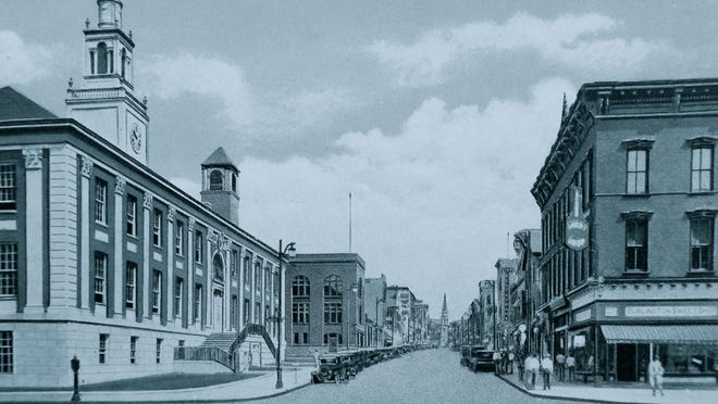 This historic photo shows Burlington's Church Street with a Greek Sweet Shop on the right corner, now Church and Main.