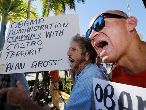 Anti-Castro activists Osvaldo Hernandez, right, and