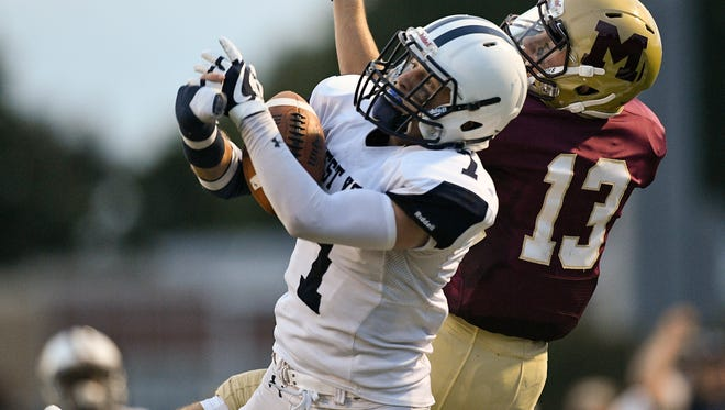 West York's Jamal Anderson (7) is called for pass interference trying break up a pass intended for Gov. Mifflin's Samuel Thompson (13) on Friday, Aug. 25. The York Dispatch Pigskin Pickers contest starts with this Friday's games.