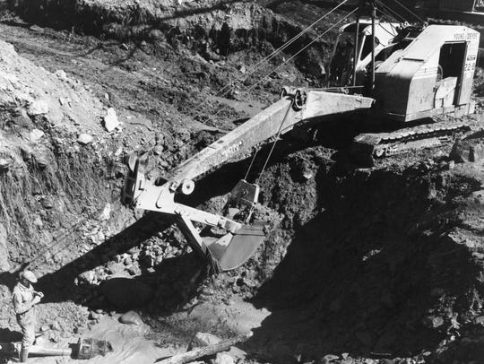 A steam shovel is used in a third attempt to find an