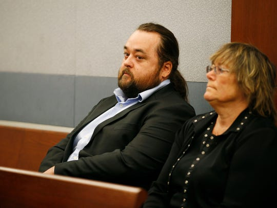 """Austin Lee Russell, left, known better as Chumlee from the TV series """"Pawn Stars,"""" appears in court Monday, May 23, 2016, in Las Vegas. Russell and his lawyers told a Las Vegas judge on Monday he intends to plead guilty in state court to felony weapon and misdemeanor attempted drug possession charges."""