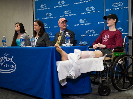 Sean English, 16, on right, speaks during a press conference