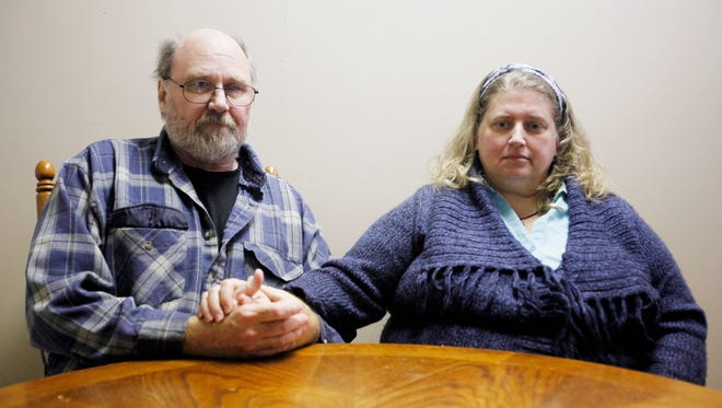 Sheri Barker, with her husband, Bill Rhodes, recently lost her daughter to a heroin overdose. Now they're hoping to get local law enforcement to adopt a program to help addicts.