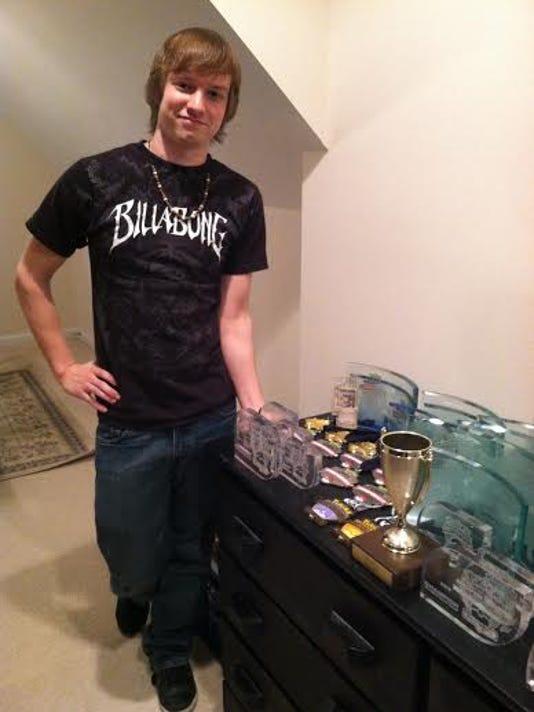 Ryan Sabelhaus with awards.jpg