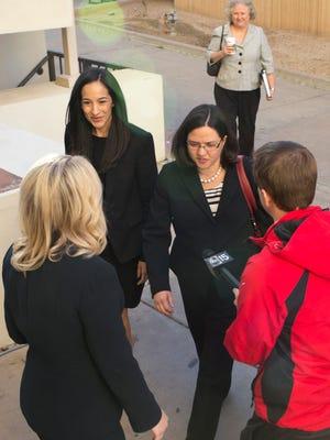 Christine Thompson, right, executive director of the Arizona Board of Education, and Sabrina Vazquez, the assistant executive director, return to work on Feb. 17, 2015.