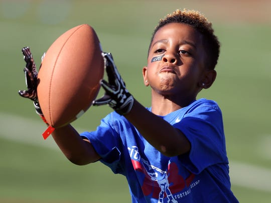 Juelz Chiron-Robinson, 6, of Spring City , PA catches