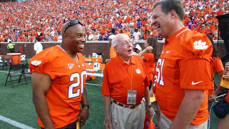 Former Clemson football player Donnell Woolford, left,