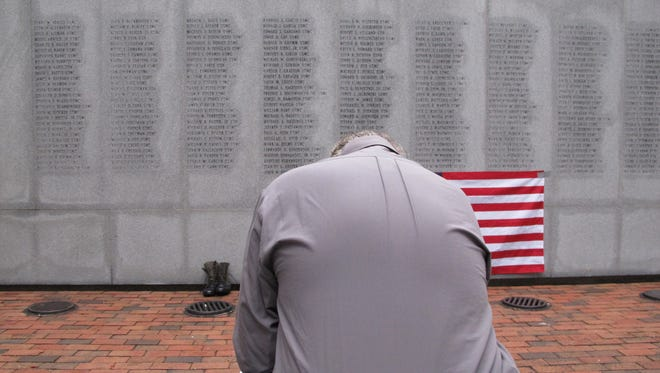 Former Marine Ed Ayers of Scranton, Penn., hangs his head and weeps at the Beirut Bombing Memorial in Jacksonville, N.C., in 2013 upon the 30th anniversary of the terrorist bombing that killed 241 U.S. service members.
