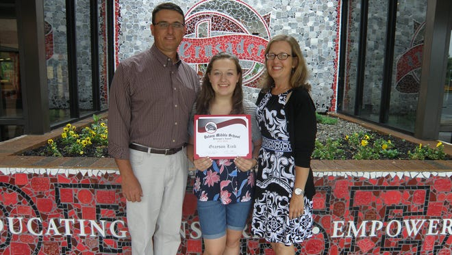 (From left) Grayson Link celebrates receiving Delsea Regional Middle School Principal's Award with her parents, Jeff Link and Amy Link.