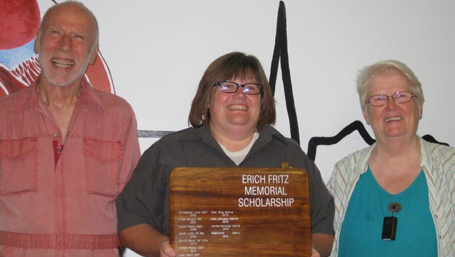 Robin Smith (center) is presented with the Erich Fritz Memorial Scholarship by Bob and Julie Fritz.