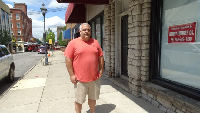 Mike Henry, owner of Henry Lumber Company, hopes the showroom's downtown location will attract more customers.