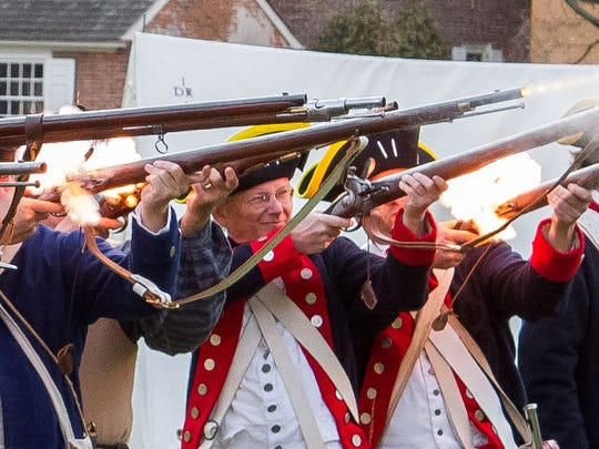 The 1st Delaware Regiment fires a volley on the green in Old New Castle