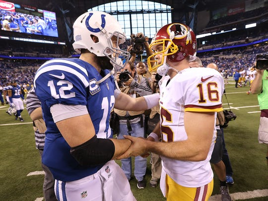 Colts quarterback Andrew Luck (12) greets Redskins