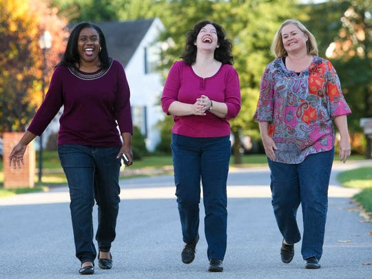 """Carrie Dennis-Mayer (left), of Fairview Farms near Middletown, and her neighbors Karen Minch (center) and Amy Carlisle walk around their neighborhood last week. """"We've all talked about so many different things,"""" Dennis-Mayer said, """"we really don't discuss race at this point."""""""