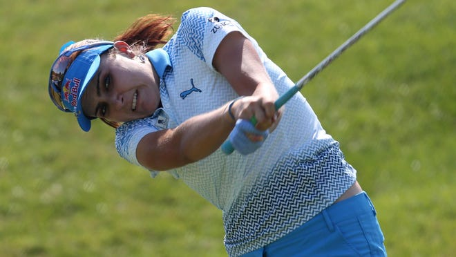 Lexi Thompson tees off on the 15th tee during action in the final round of the KPMG Women's PGA Championship at the Westchester Country Club in Harrison, June 14, 2015.
