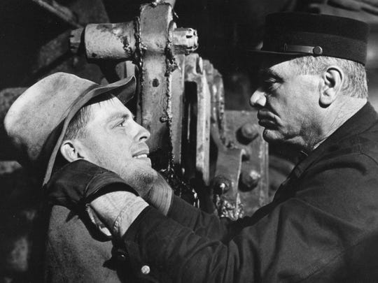 Ernest Borgnine plays a sadistic railroad conductor in Emperor of the North, seen here throttling Keith Carradine - 1973 Twentieth Century Fox publicity photo.