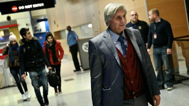 Refaai Hamo, 54, the scientist Syrian refugee, arrives to Detroit Metropolitan Wayne Country Airport with his four children on Thursday, Dec. 17, 2015 in Romulus.