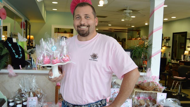 Mark Rodolico, owner of Mark's at the Pointe and a board member of Friends After Diagnosis, displays some of the goodies at a past Pink Bake Sale.