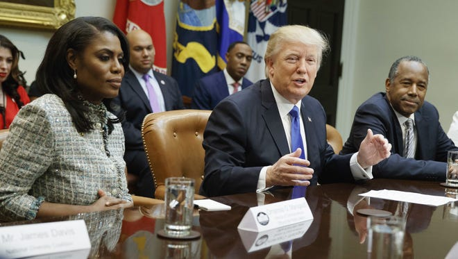 Omarosa Manigault Newman and President Donald Trump in happier times on Feb. 1, 2017, during a meeting at the White House. The former director of communications for the White House Office of Public Liaison,  Manigault Newman has made a variety of salacious, but unverified, claims against the president