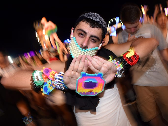 A fan dances during a performance by LNY TNZ during the 18th annual Electric Daisy Carnival at Las Vegas Motor Speedway on June 20, 2014, in Las Vegas, Nev.