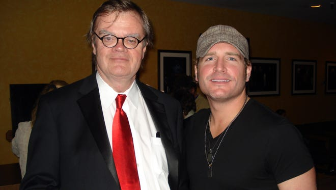 'A Prairie Home Companion' host Garrison Keillor, left, seen here at the Grand Ole Opry recently where he was a guest announcer. He's pictured with country singer Jerrod Niemann.