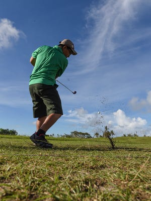 The Father Duenas Friars took to the links against the John F. Kennedy Islanders in an Independent Interscholastic Athletic Association of Guam Golf League match at the Guam International Country Club on Oct. 1.
