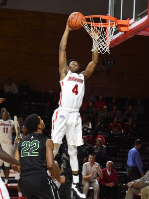 Marist College's Isaiah Lamb slams the ball as Dartmouth's Miles White looks on during a Nov. 17, 2015 game at McCann Arena.