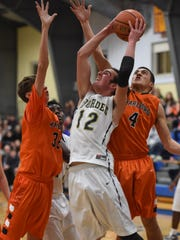 Lourdes' Luke Timm takes a shot over Marlboro's, from left, Jack Rusk and Xavier Oliver during the Duane Davis Memorial Holiday Tournament final in Poughkeepsie on Wednesday.