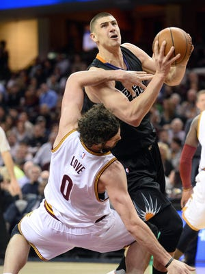 Jan 27, 2016: Phoenix Suns center Alex Len (21) runs over Cleveland Cavaliers forward Kevin Love (0) for the foul during the first quarter at Quicken Loans Arena.