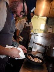 Sean Brock makes shrimp and grits in his kitchen at