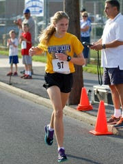 Taryn Parks, a rising freshman at Greencastle-Antim, placed second in the women's race of the Cook Mile, Saturday, beating the previous race record with a 5:09
