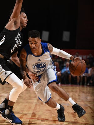 Former UW-Green Bay standout Keifer Sykes of the Golden State Warriors drives to the basket against Dejounte Murray of the San Antonio Spurs during the NBA Las Vegas Summer League.